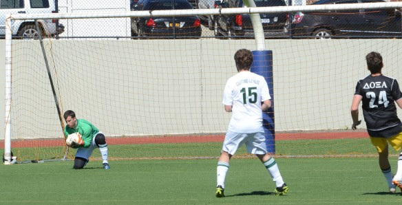 Goalkeeper Nick Meola saves easily.